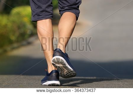 Foot Of Back Men Jogger Outdoor  In The Park Lifestyle For Exercise In Morning Good Healthy