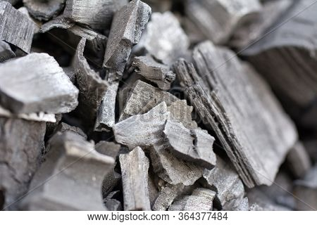 Natural Black Charcoal Texture Background. Hard Wood Charcoal For Barbecue At Picnic. Selective Focu