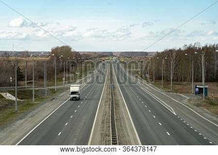 The Semi-empty Highway Is Quarantined. Reduced Traffic Due To A Virus Outbreak. An Empty Highway Wit