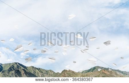 Beautiful Nature Landscape With Flying Paper Planes Among High Mountains And Cloudly Skyscape. 3d Re