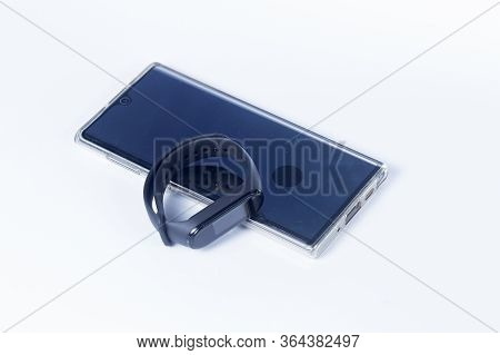 Bangkok, Thailand -april  26,2020: Samsung Galaxy Note10 And  Xiaomi Mi Band 4 Isolate On White Back