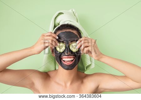 Happy Smiling Girl Applying Facial Carbon Mask Portrait - Young Woman Having Skin Care Cleanser Spa