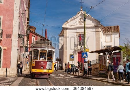 Lisbon, Portugal - 8 March 2020: Famous Yellow Tram 28 In Alfama District