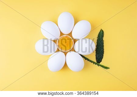 Chicken Eggs Arranged Into A Flower Shape With Exposed Egg Yolk In The Middle And Cucumber Peel As T