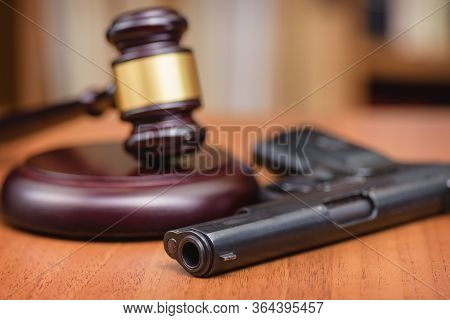 Court For The Illegal Use Of Weapons. Sentence For Murder. Judge's Gavel On Wooden Table. Judge, Ham