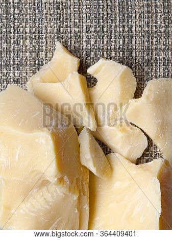 Pieces Of Natural Cocoa Butter On Green Rustic Background. Macro Photo. With Copy Space