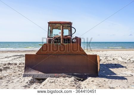 Heavy Bulldozer As Boat Puller On The Sand By The Sea, Front View