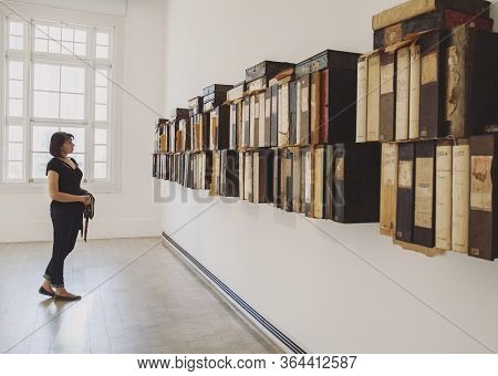Buenos Aires - November 17, 2019 - Beautiful Caucasian Woman At An Exhibition In A Gallery Next To A