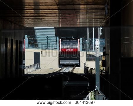 Pfaffenthal-kirchberg, Luxembourg, Luxembourg - July 4, 2019. Public Transport In City. Bright Red F