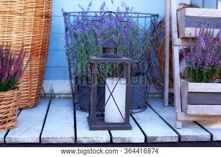 Large Street Lantern With Candle On Wooden Floor At Modern Terrace. Garden Autumn Decoration With He