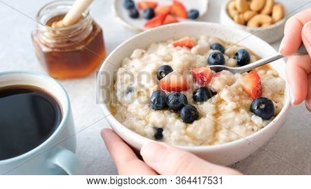 Oatmeal Porridge With Berries And Honey. Healthy Breakfast Food. Eating Healthy Breakfast Porridge O