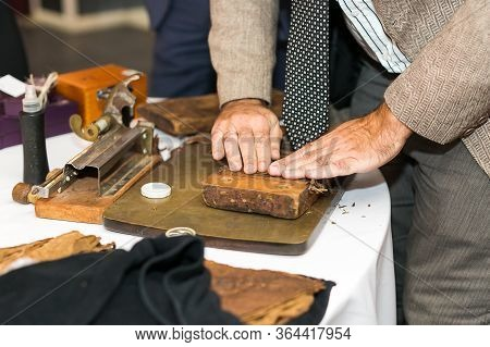 The Moment Of Making An Extra Class Cigar With The Help Of Traditional Cuban Production Tools.