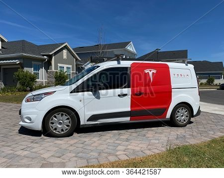 Orlando, Fl/usa-4/1/20:  A Tesla Repair Truck In The Driveway Of A Tesla Model 3 Owner Repairing The