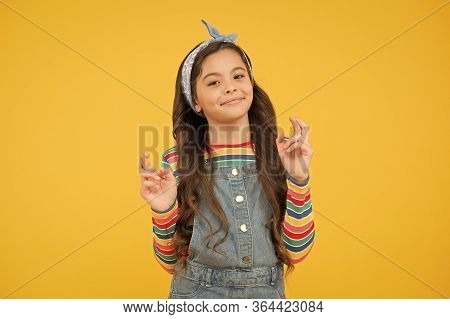 Child Dream. Hopeful Concept. Hope For Best. Believe In Herself. Cute Child Make Wish Yellow Backgro