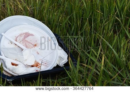 Environmental Pollution: Garbage, Plastic, Bottle. Recycling Garbage. Garbage On The Green Grass
