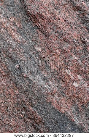 Pattern And Texture Of Natural Untreated Granite Layers. Stone Surface For Background