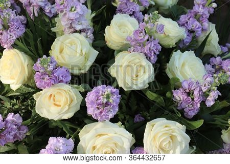 White Roses And Purple Flowers In A Big Wedding Centerpiece