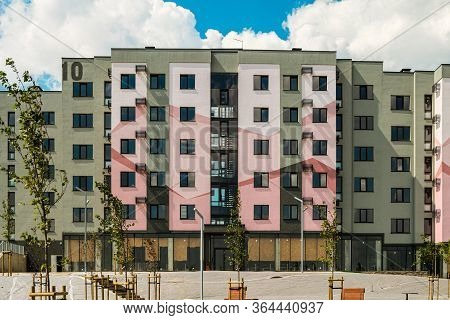 Belgorod, Russia - July 29, 2019: Facade Residential Typical Building Under A Blue Cloudy Sky. South