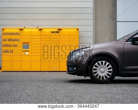 Paris, France - Mar 29, 2020: Side View Of New Skoda Octavia Car In Front Of Yellow Amazon Locker -