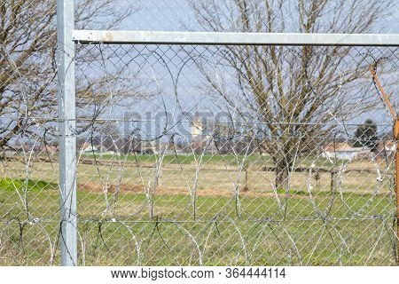 Hungarian Village Seen Through The Border Fence Between Rastina (serbia) & Bacsszentgyorgy (hungary)