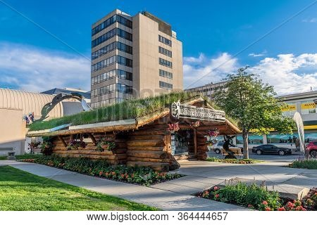 Anchorage, Alaska - June 4 - The Visitor Information Center Log Cabin With A Grass Growing Roof On J