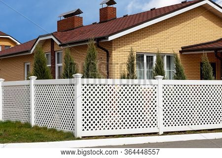 White Plastic Fence In A Modern Cottage Village.