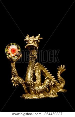 Chinese Dragon Holding A Clear Chrysanthemum Sphere