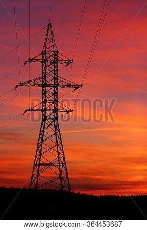 Incredibly Colorful Fiery Red Sunset. View Of Power Lines And Wires At Sunset