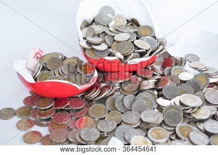 Smashed Piggy Bank There Are A Lot Of Coins. Investment Ideas For Future Profits Retirement Account
