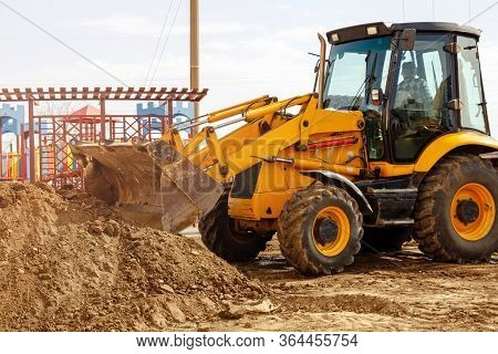 Excavator Tractor Digging A Trench For Pipenline At Construction Site