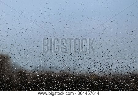 Rain Drop On Glass Window In Monsoon Season For Abstract And Background Concept.