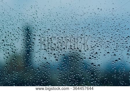 Rain Drop On Glass Window In Monsoon Season With Blurred City Background For Abstract And Background