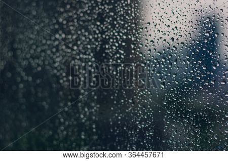 Blurred And Focus Of Rain Drop On Glass Window In Monsoon Season With Blurred Building Background Fo