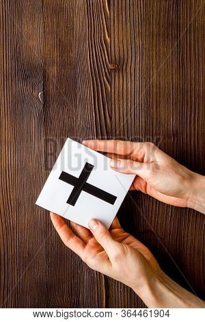 Catholic Cross Sign In Hands - Catholicism Religion Concept - On Wooden Background Top View Copy Spa