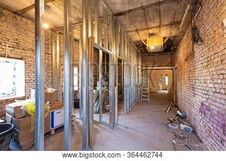 Working Process Of Installing Plasterboard Or Drywall For Making Gypsum Walls In Apartment Is Under