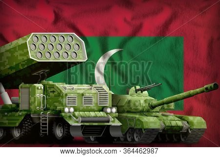 Tank And Rocket Launcher With Summer Pixel Camouflage On The Maldives Flag Background. Maldives Heav