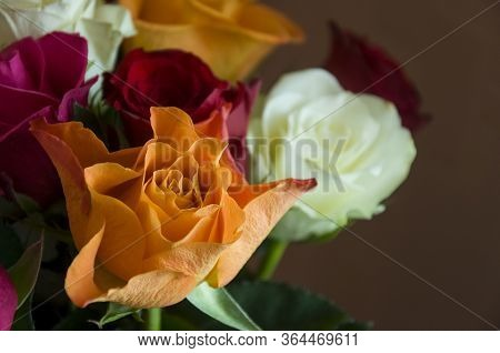 Lovely Big Colorful Bouquet With Many Flowers  Roses Of Red, Vinous, Orange And White Colors. Green