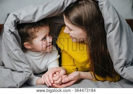 Front View Of Young Mother And Little Girl Enjoying Sweet Moments Of Parent And Kid Bonding Together