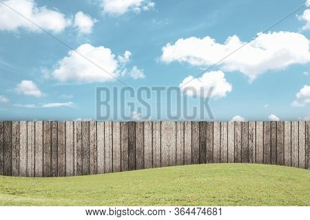 Empty Wooden Garden Fence At Backyard And Blue Sky Background At A Summer Day
