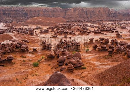 Hoodoo - high thin geological formations. Goblin Valley is a scenic Utah state park, USA. Many funny and bizarre figures of red-brown sandstone. The concept of  ecological and photo tourism