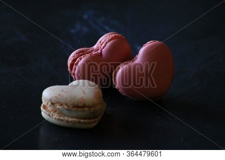 Heart-shaped Macaroons On Dark Background. Macaroons Heart. Valentines Day.