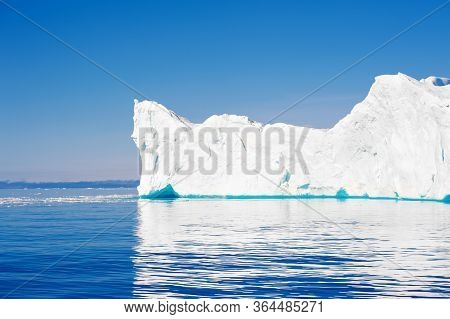 Big Blue Icebergs In The Atlantic Ocean. Ilulissat Icefjord, Western Greenland