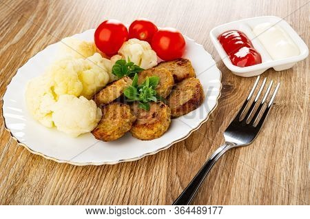 White Glass Plate With Boiled Cauliflower, Tomato Cherry, Small Chicken Cutlets, Basil, Partitioned