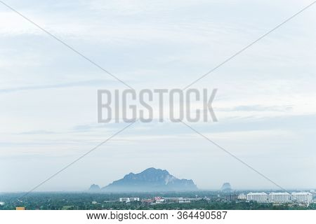 Cityscape View Over Blue Clouds Sky ,look At Khao Nang Phanthurat Mountain With Forest Behind The Mo