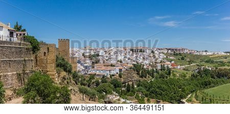 Panorama Of The City Wall And Surrounding Landscape Of Ronda, Spain