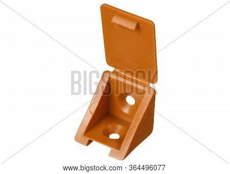 Open Plastic Furniture Corner Light Of Brown Color Isolated On A White Background. Furniture Fitting
