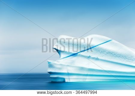 Big Blue Iceberg In The Atlantic Ocean. Ilulissat Icefjord, Western Greenland