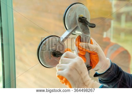 Engineer Use Tool Install Glass In Building Construction Site,building Glass Technician.