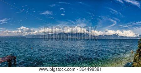 Garda Lake Coast On A Sunny Day With Beautiful Clouds