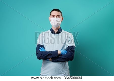 Volunteer Wearing Medical Glovesand Mask. Concept Of Donations, Support And Volunteering.